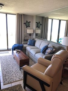 Living room with sectional couch including chaise and full size sleeper sofa