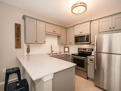 Photo for Stunning Newly Renovated Condo! FREE Parasailing & Golf!