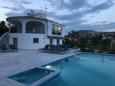 Photo for 6 bedroom luxury villa, sea view, flat short walk to beach and town, heated pool