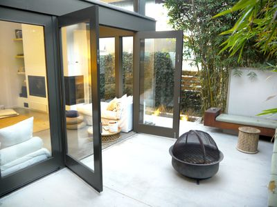 Bring the Outdoors into the Living Room w Glass Walls that Open to Bamboo Porch.