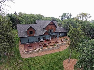Waterfront property on 3 acres with home theater and large deck.