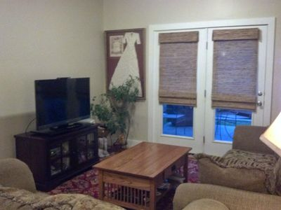Comfy couch room with flat screen TV. Open doors on warm nights.