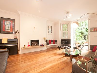 Photo for Light and airy 3 bed in leafy Hampstead, with lovely outside space (Veeve)