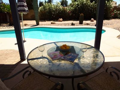 Enjoy a cold beverage on the shaded patio overlooking the pool.