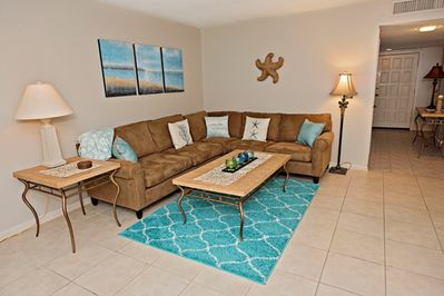 "Family room with seating for 6 to enjoy 50'"" HD flat screen TV."