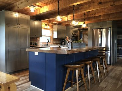 """3"""" slab walnut on island, granite on other countertops, all new cabinetry"""