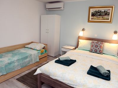 Photo for Guesthouse Portoroz Triple Room with Garden View