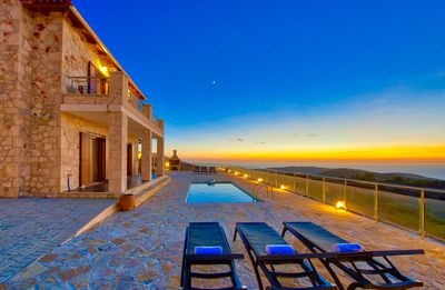 Photo for Stone-built villa with private pool and amazing views over the sea and sunset