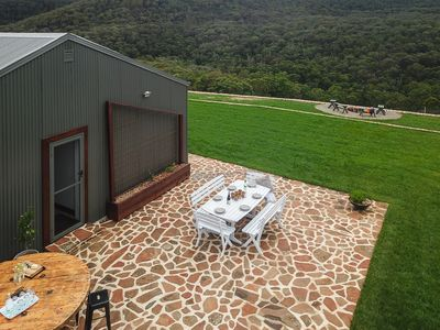 Drone shot of the outdoor entertaining area to the bush beyond