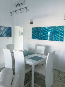 Dining area showing the beautiful artwork
