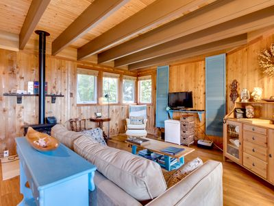 Photo for Artistic and whimsical cottage only minutes from the beach!