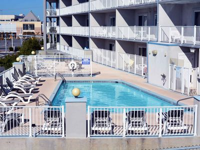 Cozy but classy 3 bedroom ocean block condo with free WiFi and an outdoor pool located near downtown and just a brief stroll to the beach!