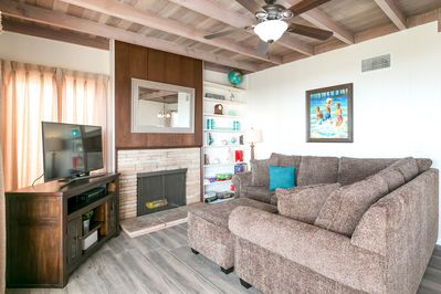 """Living Room - For entertainment in the living room, you'll have a 40"""" flat-screen TV and plenty of board games"""
