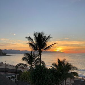 Photo for Beachfront condo with stunning ocean views in the heart of Romantic Zone