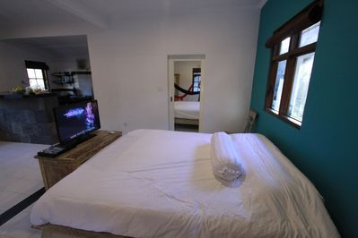 King size bed with fresh white bedding