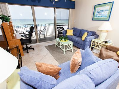 Living Room - Enjoy relaxing evening in your three bedroom vacation spot as you watch a breathtaking sunset.