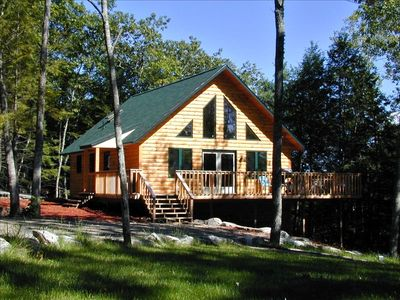 New chalet style cottage with wrap around deck on quiet country lane.