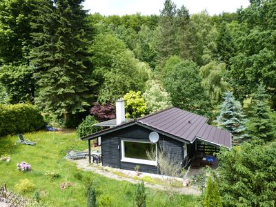 Photo for Wooden bungalow in the Reinhardswald nature park with 1,000 m² of land - near Kassel