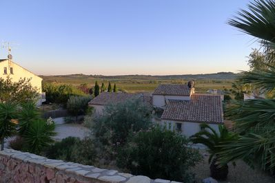 House and evening view across vineyards from top of drive
