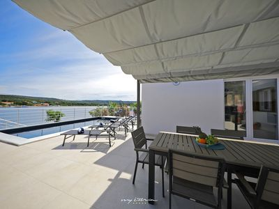 Photo for Modern seafront villa with pool in Zadar region