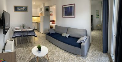Photo for Design apartment with air conditioning terrace and barbecue 50 m from the beach