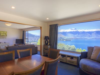 Photo for Sweeping mountain and lake views | 5 minute drive to town | Modern charm