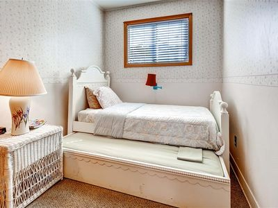 this quaint bedroom offers 2 twin beds one of which is a trundle
