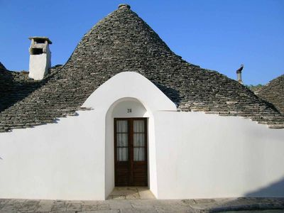 Photo for In the historic center magnificent trullo with courtyard and garden.