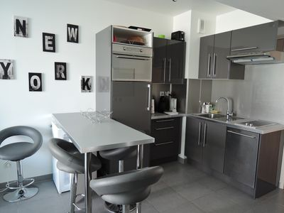 Photo for Air-conditioned apartment with parking and balcony close to the city center