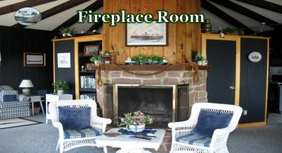 A red granite, real fireplace. Fire wood on back porch for any cool nights.