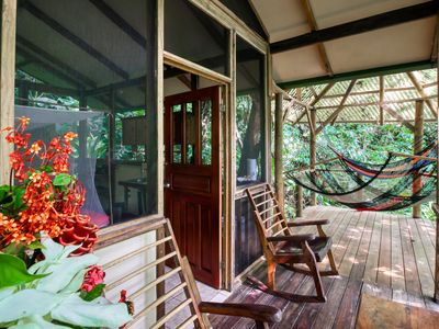 Photo for Stunning treetop retreat w/furnished balcony & hammock overlooking the jungle!