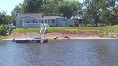 Photo for Beautiful Riverside Beach House with private dock/beach frontage