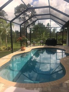 Heated salt water pool with seating and sundeck built into pool