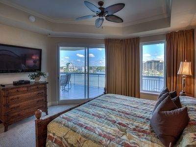 Master bedroom with floor to ceiling windows and direct balcony access