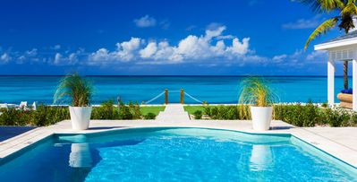 4 bd. family friendly villa, steps to Grace Bay Beach, pool, beach lounge