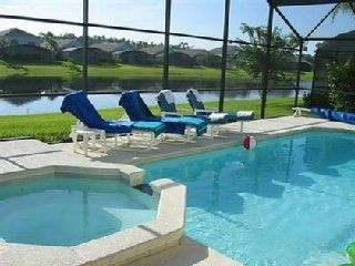 Photo for 5 Star Luxury 4 Bed Villa with Sun Facing Pool / Spa, Lake view, near Disney