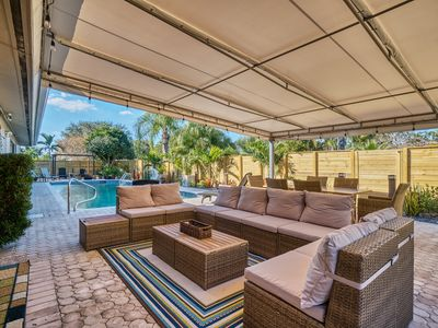 Photo for Heated Pool Home!  Walk to Restaurants and 1.5 miles to Beach!