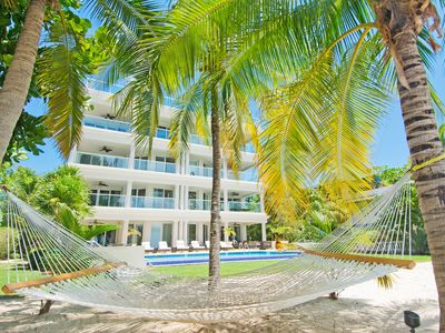 Photo for Gorgeous Luxury Beachfront Condo On Seven Mile Beach - 4 bed, Sleeps 10