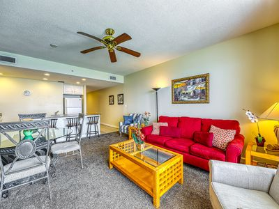 Photo for Sterling Reef beach getaway! Steps from the beach, shared pool, hot tub, & gym!