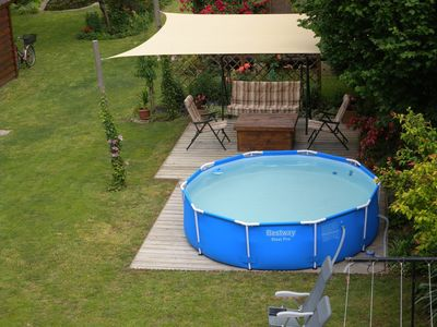 Holiday apartment with garden pond, sandpit and children's pool