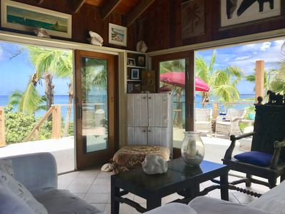 Living room and views to expansive deck and ocean.