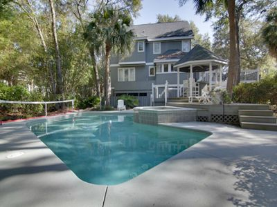 Pool Area with Hot Tub, Cabana, and Deck. Pool Chairs and Tables