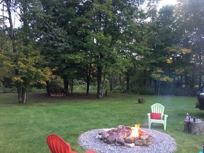 Easy living.  Summer view of the spacious backyard area bordering the Creek.