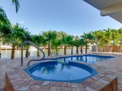 Photo for Lovely canal-front condos for large groups! Private pool, hot tub, ocean access