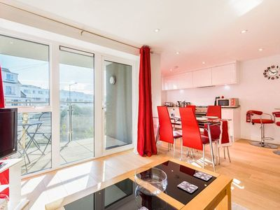 Photo for Couple friendly contemporary apartment a stones throw from Fistral Beach. Secure underground parking