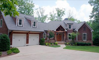 Photo for Magnificent Reynolds Plantation  Lakefront Home: 5 Bedrooms