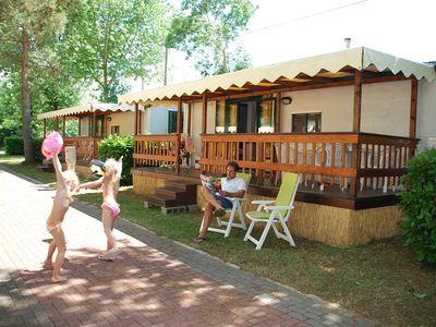 Photo for Mobile home directly on Lake Trasimeno on campsite with swimming pool with slides