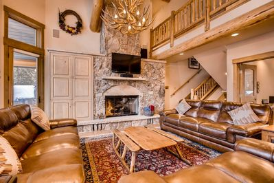 Relax with easefulness  - by fireside in this spacious and comfy living room