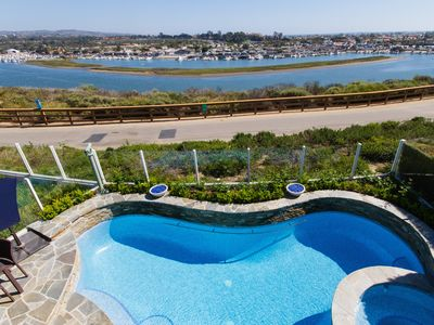 Photo for Celebrity Designer Gated View Home With All Tile Salt Water Pool