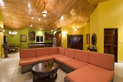 Living area with large sectional sofa and brilliant colors!